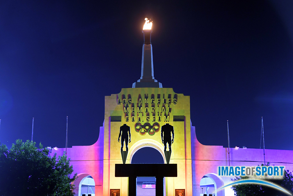 Sep 12, 2017; Los Angeles, CA, USA; General overall view of the Los Angeles Memorial Coliseum and Olympic torch illuminated in the colors of the LA2028 logo to commemorate the awarding of the 2028 Olympics and Paralympics to Los Angeles.