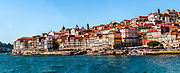Panoramic cityscape of Ribeira, Old Town, Porto, Portugal as seen from Vila Nova de Gaia across the Douro River