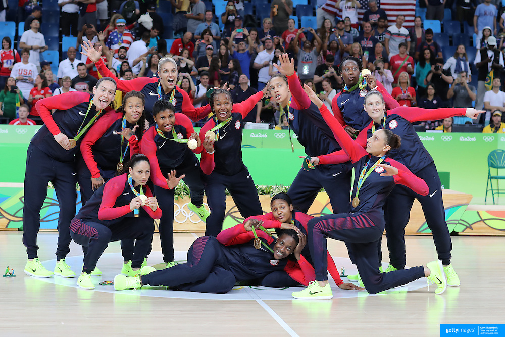 Basketball - Olympics: Day 15   Unites States players strike a pose after receiving their gold medals, players include, Lindsay Whalen #4, Seimone Augustus #5, Sue Bird #6,  Maya Moore #7, Angel Mccoughtry #8, Breanna Stewart #9, Tamika Catchings #10,  Elena Delle Donne #11, Diana Taurasi #12, Sylvia Fowles #13, Tina Charles #14 and Brittney Griner #15 after the USA Vs Spain Women's Basketball Final at Carioca Arena1 on August 20, 2016 in Rio de Janeiro, Brazil. (Photo by Tim Clayton/Corbis via Getty Images)