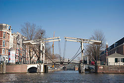 "(""Skinny Bridge"") is a bridge over the river Amstel, Amsterdam"