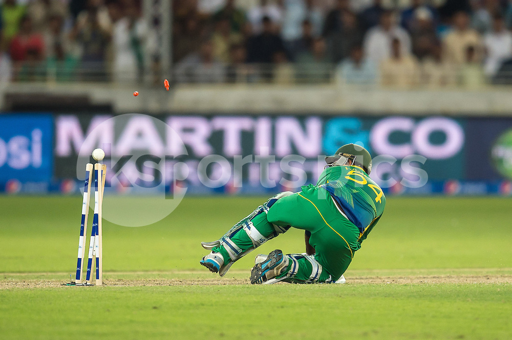 Sarfraz Ahmed of Pakistan loses his wicket during the 2nd International T20 Series match between Pakistan and England at Dubai International Cricket Stadium, Dubai, UAE on 27 November 2015. Photo by Grant Winter.