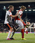 Danny Ward shielding the ball from Michael Turner during the Sky Bet Championship match between Fulham and Rotherham United at Craven Cottage, London, England on 15 April 2015. Photo by Matthew Redman.