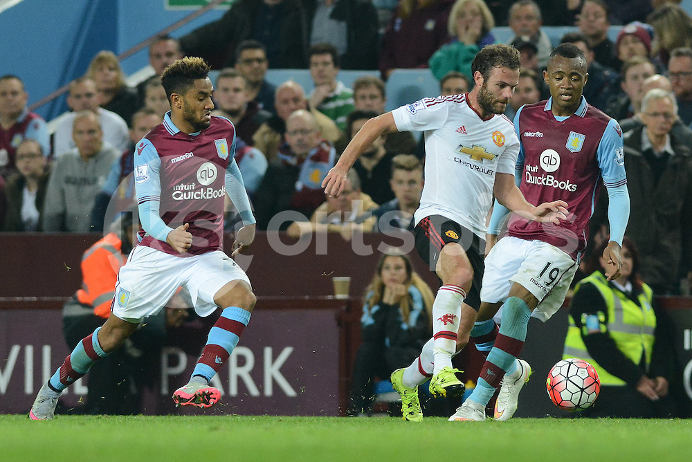 Manchester United's Juan Mata tracked by Aston Villa's Jordan Amavi  and Jordan Ayew during the Barclays Premier League match between Aston Villa and Manchester United at Villa Park, Birmingham, England on 14 August 2015. Photo by Garry Griffiths.