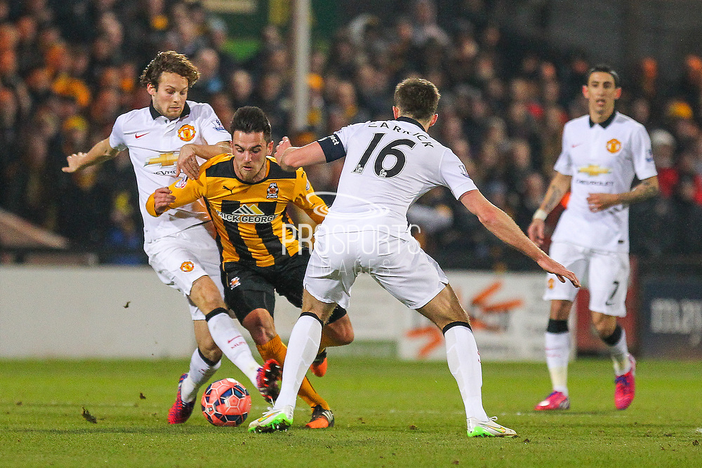 Cambridge United Ryan Donaldson battles during the The FA Cup match between Cambridge United and Manchester United at the R Costings Abbey Stadium, Cambridge, England on 23 January 2015. Photo by Phil Duncan.