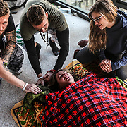 """Surrounded by friends Mallory Branch, who lost her brother to opioid addiction cries  after smoking the venom bufo alvarius, a rare toad found in the Mexican desert, during a """"healing ceremony""""  under the watch of """"shaman/sitter"""" named Madhu in Lexington on Thursday, October 19, 2017."""