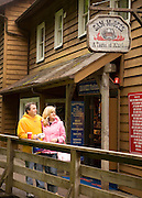 "USA, Alaska,ketchikan,Tourists enjoy the converted historic ""Red Light"" district on Ketchikan's ""Creek Street"""