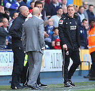 Ian Holloway , Manager of Millwall (2nd left) and Eddie Howe , Manager of Bournemouth (right) exchange heated words during the Sky Bet Championship match at The Den, London<br /> Picture by David Horn/Focus Images Ltd +44 7545 970036<br /> 03/05/2014