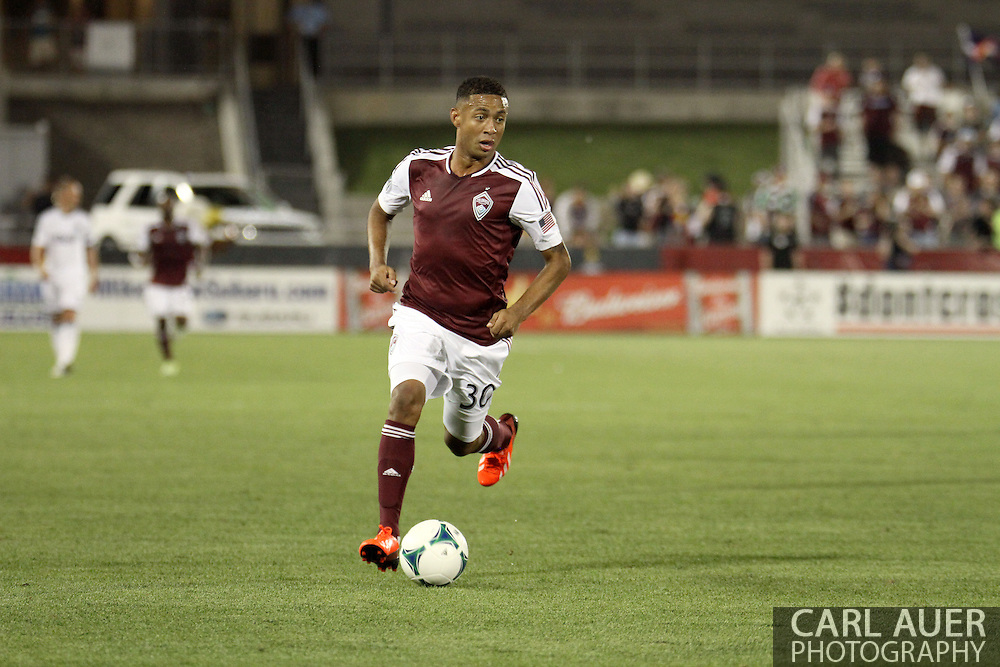 August 17th, 2013 - Colorado Rapids forward Gabriel Torres (30) dribbles the ball up the field in the second half of action in the Major League Soccer match between the Vancouver Whitecaps FC and the Colorado Rapids at Dick's Sporting Goods Park in Commerce City, CO