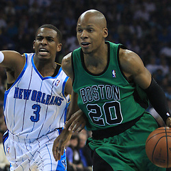 11 February 2009: Boston Celtics guard Ray Allen (20) drives past New Orleans Hornets guard Chris Paul (3) during a NBA game between the Boston Celtics and the New Orleans Hornets at the New Orleans Arena in New Orleans, LA.