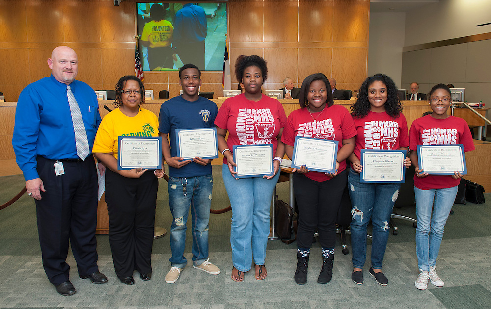 L-R: Worthing High School principal Tod Nix, NHS advisor Victoria Syes, LaDonte Lotts, Brianna Ray-Williams, Elizabeth Henderson, Chaquette Blanks, and Chasitee Crossley pose for a photograph after receiving Certificates of Recognition during the monthly meeting of the Houston ISD Board of Trustees' meeting, April 11, 2013.