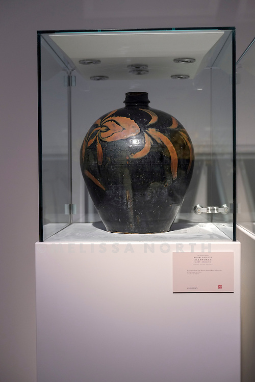 A Large Cizhou-Type Russet-Panted Black-Glazed Jar from the touring highlights of The Collection of Robert Hatfield Ellsworth, on display<br /> at Christies in King St, London, UK on Tuesday 16th December 2014. In celebration of this unparalleled collection of Asian Art, Christie&rsquo;s will host a series of auctions and online-only sales during New York Asian Art Week in March 2015. Photo by Melissa North. Ref B5690