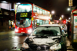 © Licensed to London News Pictures. 12/01/2017. London, UK. Snow is seen on cars in Camden, north London as the first snow of the season starts to fall in London on Thursday, 12 January 2017. Photo credit: Tolga Akmen/LNP