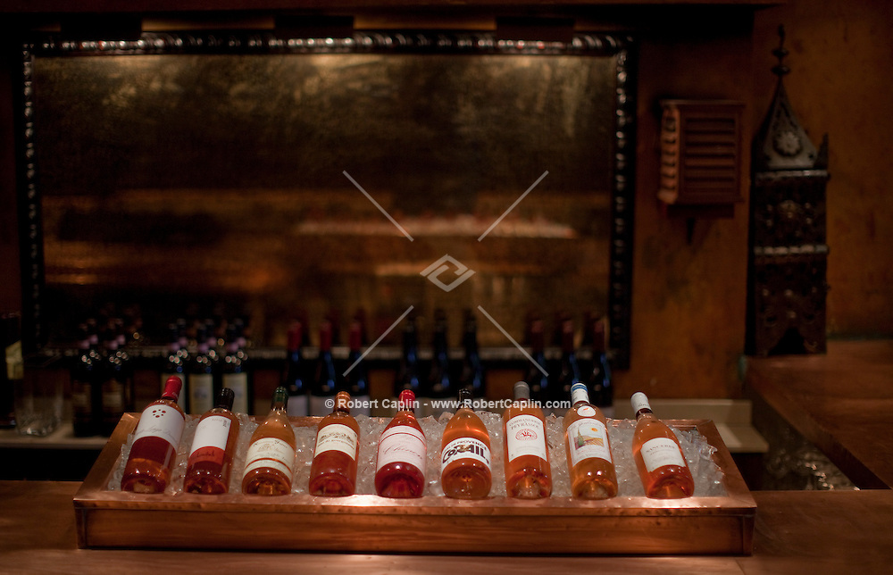 A selections of rosés on display Alta, a restaurant in New York that has excellent selection of wines under $50 a bottle. All rosés on display are under $50/bottle. ..Photo by Robert Caplin.