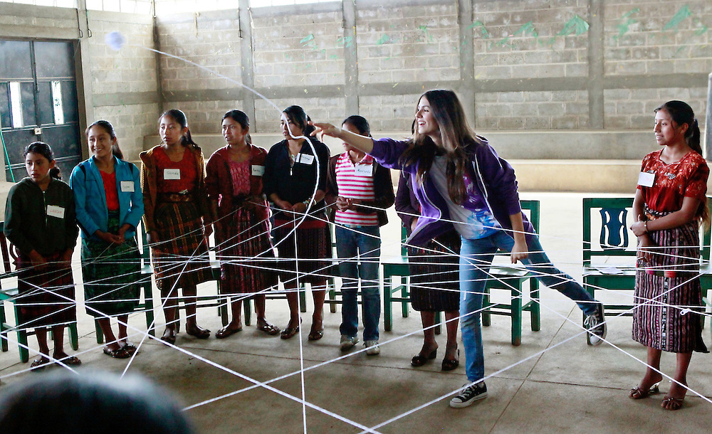"Television star and Girl Up Champion Victoria Justice, joins adolescent girls in playing a game with string at the ChildFund project 'Mujeres Seguras"", where adolescent mentors are trained to provide instruction in preventing gender violence in their communities, Chichicastenango, Guatemala, Tuesday, Aug. 30, 2011. Justice is here to learn about Girl Up's work to support the work of the United Nations to help girls in developing countries. (Stuart Ramson/Insider Images for UN Foundation)"