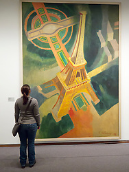 woman looking at painting The Eiffel Tower by Robert Delaunay  in Neue Nationalgalerie in Kulturforum in Berlin Germany