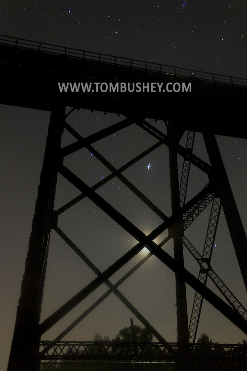 Salisbury Mills, New York  - Stars shine above and between the beams of the Moodna Viaduct railroad trestle on the night of Sept. 29, 2013.