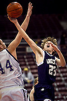 JEROME A. POLLOS/Press..J.J. Stoddard from Lake City High goes up for a shot against the defense of Rocky Mountain High's Ryan Strand during the first half of their game Friday at the state 5A boys basketball tournament at Idaho Center in Nampa. The T-Wolves were eliminated from the tournament after the 72-52 loss to the Grizzlies.