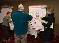 Luke Powell and Brenda Cobis add ideas to the Economic Development board during Re-Imagine Laconia at the Opechee Conference Center Wednesday evening.  (Karen Bobotas Photographer)
