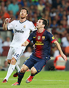 Lionel Messi attacks for Barcelona.  Barcelona v Real Madrid, Supercopa first leg, Camp Nou, Barcelona, 23rd August 2012...Credit - Eoin Mundow/Cleva Media.