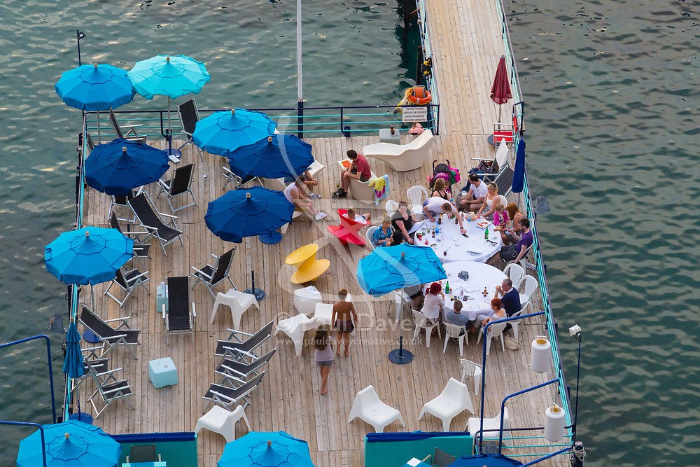 Sorrento, Italy, September 16 2017. People enjoy late afternoon drinks on a jetty in Marina Santo Francesco, Sorrento, Italy. © Paul Davey