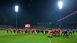 ZENICA, BOSNIA & HERZEGOVINA - Saturday, October 10, 2015: Wales players celebrate qualifying for the Euro 2016 finals despite a 2-0 defeat to Bosnia and Herzegovina during the UEFA Euro 2016 qualifying match at Stadion Bilino Polje. (Pic by David Rawcliffe/Propaganda)