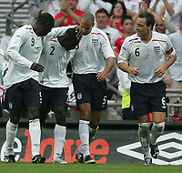 Photo: Lee Earle.<br /> England v Israel. UEFA European Championships Qualifying. 08/09/2007.Micah Richards (2ndL) is congratulated after scoring England's third goal.