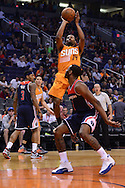 Apr 1, 2016; Phoenix, AZ, USA; Phoenix Suns guard Ronnie Price (14) shoots the ball over Washington Wizards guard John Wall (2) in the second half at Talking Stick Resort Arena. The Washington Wizards won 106- 99. Mandatory Credit: Jennifer Stewart-USA TODAY Sports