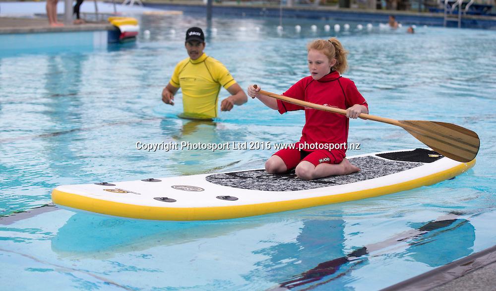 Stevie Durston, 8 tries SUP in the pool with Seaton Rolleston. Flight Centre Foundation Halberg Water Sports Day, Waikanae Beach, Gisborne, New Zealand. Saturday, 26 November, 2016. Copyright photo: John Cowpland / www.photosport.nz