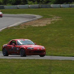 May 23, 2009; Lakeville, CT, USA; The Flatout Motorsports Mazda MX-5 qualifies for Grand-Am Koni Sports Car Challenge series competition during the Memorial Day Road Racing Classic weekend at Lime Rock Park.