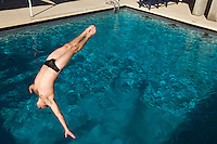 Young man diving into swimming pool