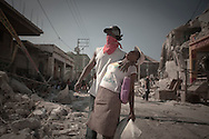 Port-Au-Prince, Haiti, January 15 of 2010:  Victims of the 2010 Haitian earthquake struggle to survive in Port-au-Prince. More than 316.000 people were killed in this disaster. Photo: Caio Guatelli.