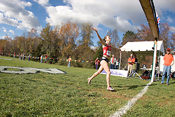 North Carolina State University's Julia Lucas celebrates as she crosses the line in first place at the 2006 ACC Cross Country Championships in Charlottesville, VA on October 28, 2006.