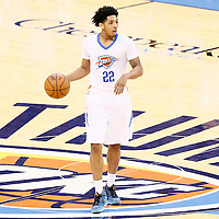 06 May 2016: Oklahoma City Thunder guard Cameron Payne (22) brings the ball up court during the San Antonio Spurs 100-96 victory over the Oklahoma City Thunder, during Game Three of the Western Conference Semifinals of the NBA Playoffs at the Chesapeake Energy Arena, Oklahoma City, Oklahoma, USA.