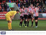 Danny Wright celebrates his second goal  during the Vanarama National League match between Cheltenham Town and Bromley at Whaddon Road, Cheltenham, England on 30 January 2016. Photo by Antony Thompson.