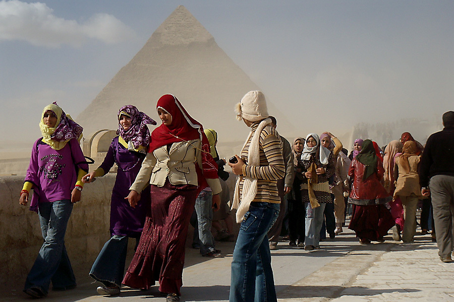 Young girls walk toward the Great Sphinx from the Giza Plateau.