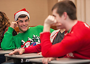 Joe Emering and Ben Mcintosh, freshmen, joke around during The College of Business Honors Program's Christmas party in Copeland Hall on Wednesday, December 5, 2012.