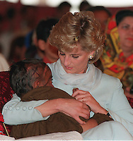 Diana, Princess of Wales. comforts a child during a visit to Imran Khan's Cancer Hospital in Lahore, Pakistan in April, 1996..Photo:  Anwar Hussein