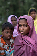 Just arrived by boat from Myanmar, Mohammed Saber, 3 yrs, with his mother Tayeba Khatu, 20 yrs who made the journey to Bangladesh with thirty-seven other Rohingya refugees.<br /> <br /> Often described as the &quot;world's most persecuted minority&quot;. The Rohingya are a Muslim ethnic group from the Rakhine State in Myanmar.<br /> <br /> In October 2016, a military crackdown in the wake of a deadly attack on an army post sent hundreds of thousands of Rohingya fleeing to neighbouring Bangladesh.<br /> <br /> Similar attacks in August 2017 led to the ongoing military crackdown, which has led to a new mass exodus of Rohingya. Most Rohingya have sought refuge in and around Cox's Bazar in Bangladesh, often crossing by boat and then making the long march to nearby checkpoints and registration centres - Photograph by David Dare Parker