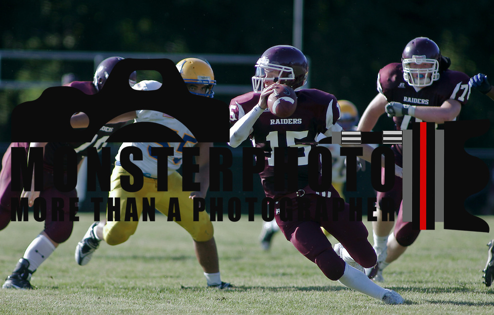 9/17/10 Wilmington DE: Concord QB (#15) Jeffrey Paige scrambles away from Caesar Rodney DL (#55) Aaron Wright during game action at Concord High School in Wilmington Delaware. The Caesar Rodney Riders defeated The Concord Raiders 46-29. Special to The News Journal/SAQUAN STIMPSON