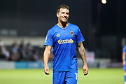 AFC Wimbledon striker Cody McDonald (10) smiling during the EFL Trophy match between Barnet and AFC Wimbledon at Underhill Stadium, London, England on 29 August 2017. Photo by Matthew Redman.