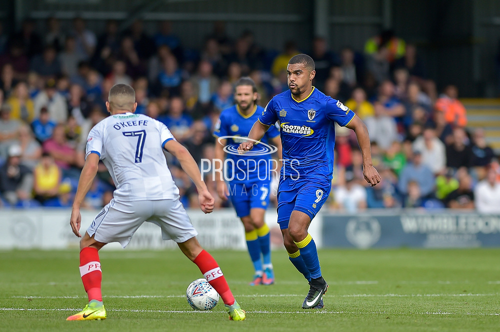 AFC Wimbledon Forward, Kwesi Appiah (9) takes on Portsmouth Midfielder, Stuart O'Keefe (7) during the EFL Sky Bet League 1 match between AFC Wimbledon and Portsmouth at the Cherry Red Records Stadium, Kingston, England on 9 September 2017. Photo by Adam Rivers.