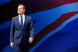 © Licensed to London News Pictures. 07/10/2015. Manchester, UK. Prime Minister DAVID CAMERON walking to the stage to deliver a speech at Conservative Party Conference at Manchester Central convention centre on Wednesday, 7 October 2015. Photo credit: Tolga Akmen/LNP