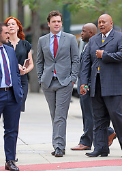 """Taylor Swift v David Mueller trial in Denver day five arrivals at court. Pictured Taylor Swift's brother, Austin, publicist Tree Paine and security detail leaving the Ritz-Carlton hotel to walk to the nearby courthouse. Also sign in a nearby office window that reads """"FEARLESS."""". 11 Aug 2017 Pictured: Taylor Swift v David Mueller day five courthouse arrivals. Photo credit: Leigh Green/MEGA TheMegaAgency.com +1 888 505 6342"""