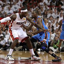 Jun 17, 2012; Miam, FL, USA; Miami Heat small forward LeBron James (6) drives against Oklahoma City Thunder small forward Kevin Durant (35) during the first quarter in game three in the 2012 NBA Finals at the American Airlines Arena. Mandatory Credit: Derick E. Hingle-US PRESSWIRE