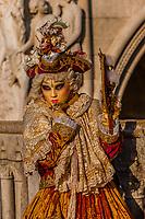 Woman in carnival costume, Bridge of Sighs, Venice Carnival (Carnevale di Venezia), Venice, Italy