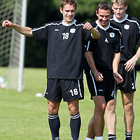St Johnstone Training...08.08.03<br />Paul Bernard back fit , shares a joke with John Robertson during training and looking forward to facing Queen of the South tomorrow.<br />see story by Gordon Bannerman Tel: 01738 553978<br />Picture by Graeme Hart.<br />Copyright Perthshire Picture Agency<br />Tel: 01738 623350  Mobile: 07990 594431