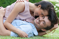 Portrait of loving young couple enjoying together in park