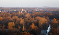 © Licensed to London News Pictures. 16/02/2014. Winchester, Hampshire, UK. A view of Winchester cathedral bathed in golden light at Sunrise today, 16th February 2014. The sunshine offers respite to the seemingly never ending stormy period experienced in the UK. Photo credit : Rob Arnold/LNP