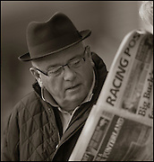 The last meeting at Folkestone Racecourse, Westenhanger, Kent, 18th December 2012..A punter looks at the racing post before a race.