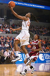 Virginia forward Monica Wright (22) shoots a layup past Rider forward Shaunice Parker (15).  The #15 ranked Virginia Cavaliers defeated the Rider Broncs 83-38 in the Marriott Cavalier Classic Basketball Tournament at the John Paul Jones Arena on the Grounds of the University of Virginia in Charlottesville, VA on December 28, 2008.